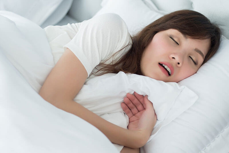 woman sleeping with mouth ooen